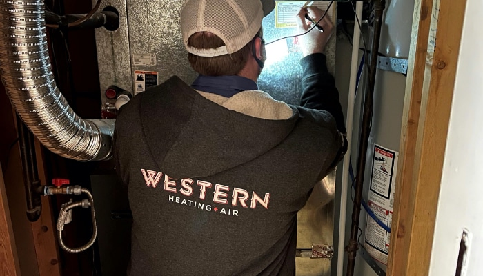 Technician Completing Furnace Maintenance